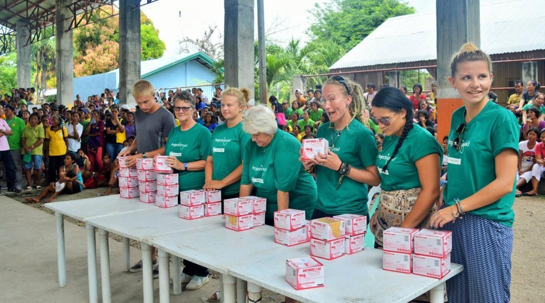 Interns distribute larvicide to combat dengue fever as part of their group Public Health work in the Philippines.